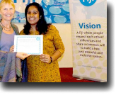 Alzima Bano, one of the mediators at the training on dialogue facilitation, receives her certificate from Lead Facilitator Sylvia McMechan.