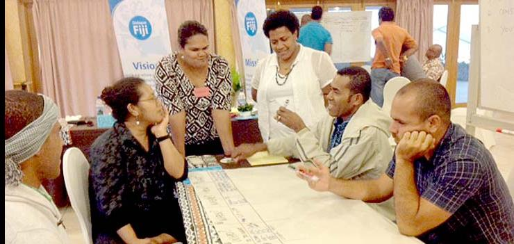 Sept 2013: Fijian mediators and facilitators participating in a group based activity on how to conducts dialogues.