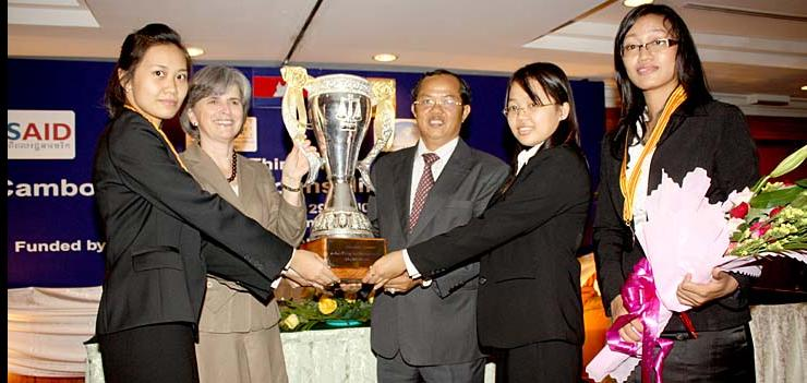 Winners of the Winners of the 2010 competition at a ceremony with the US Ambassador & President of Cambodia's Bar Association.