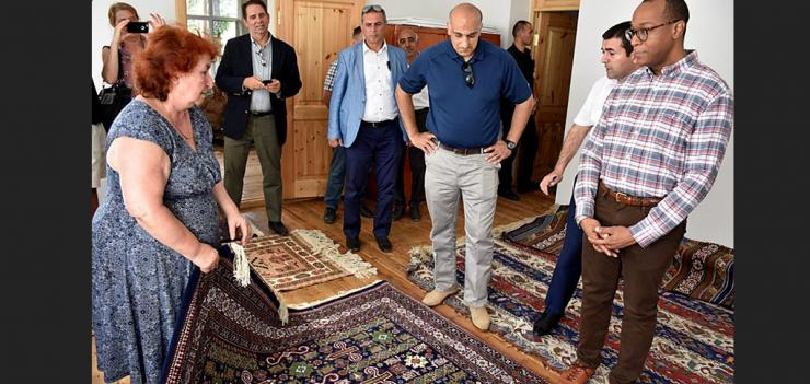 U.S. Chargé d'Affaires and USAID Mission Director at the carpet-weaving workshop in Guba