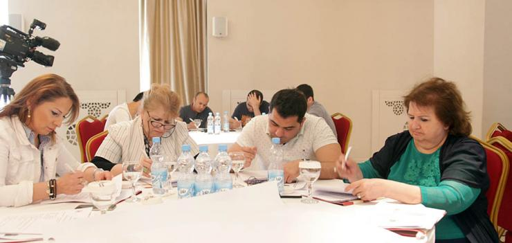 CSSN participants work in groups to prepare a presentation on formulating goals and indicators.