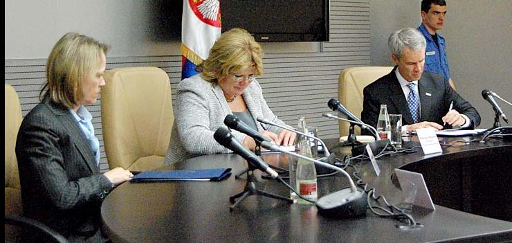 L to R: US Ambassador Warlick, HCC President Mesarovic, and Mission Director Harvey