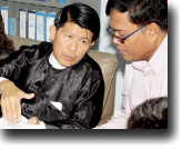Sotheara Chhim, Executive Director of the Transcultural Psychosocial Organization Cambodia (right), consults with visitors Burma representives from the Assistance Association for Political Prisoners and Social Action for Women on mental health.
