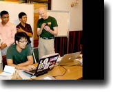 Cambodian Eng Vannak codes as Mozilla representative speaks with localization team.